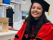 smiling female graduate student